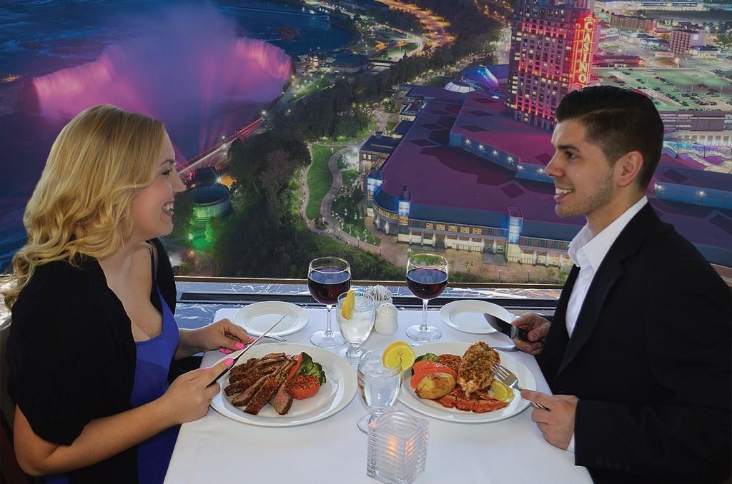Couple Dining at Skylon Tower Niagara Falls at Night