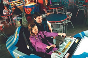 a brother and sister duo enjoying interactive games at the Skylon Fun Centre