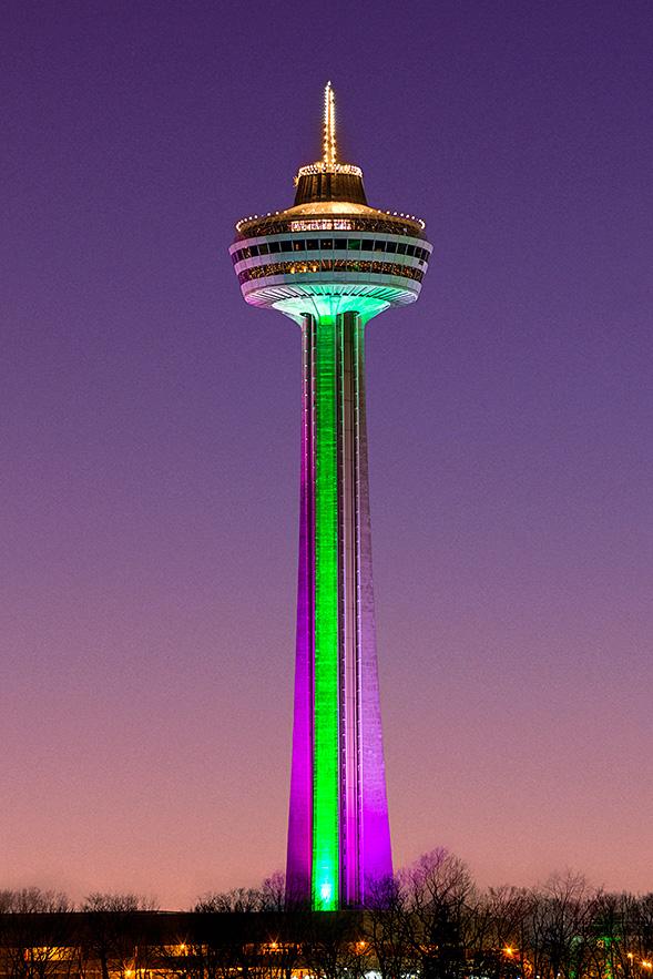 skylon tower lit purple green
