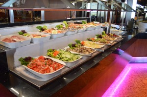 A full view of one of our Skylon Tower buffet table filled with delicious food in our Revolving Restaurant