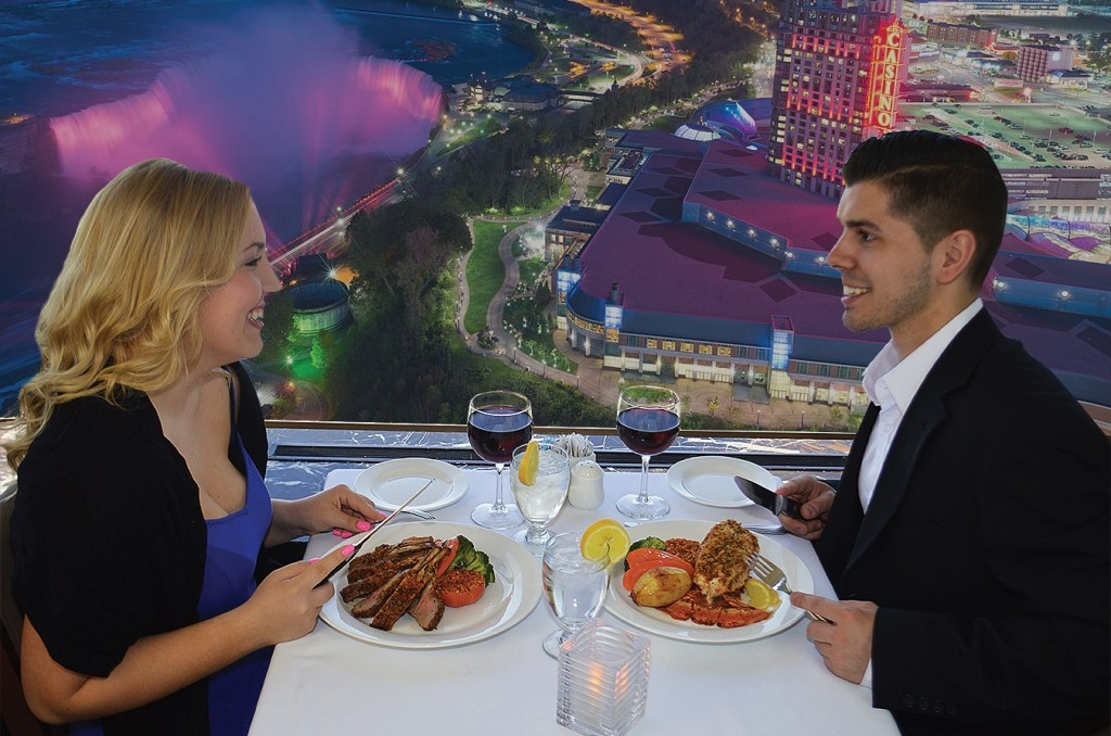 couple on a date at skylon tower with a view of niagara falls