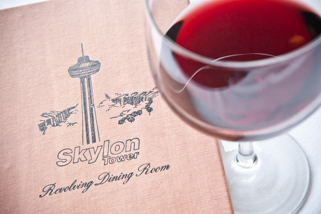 skylon menu with glass of wine in foreground