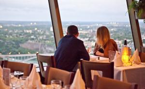 a couple enjoying an intimate dinner at our Skylon Tower Revolving Restaurant