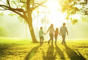 Family walking together in the sunset